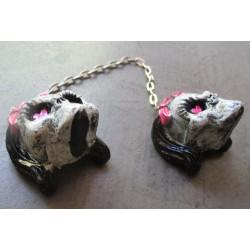 paire de crane fillette  noeud rose monstre en resine  pour retroviseur