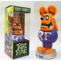 figurine rat fink tete orange corp violet  avec les mains dans le dos
