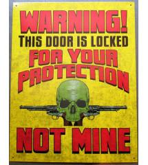 plaque warning the door is...