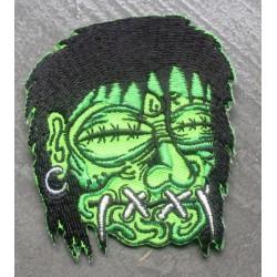 patch shrunken head vert yeux et bouche cousu ecusson rock